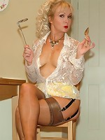Housewife plays with kitchen utensils
