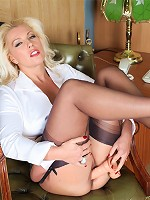 Lana has some downtime in the office so she decides to be naughty with her big fleshy cock toy